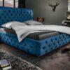 LuxD Dizajnová posteľ Laney 180x200 cm tmavomodrý zamat